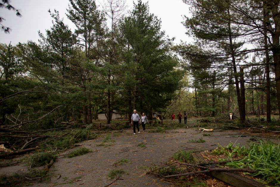 Groups of people walk through Wharton Brook State Park in Wallingford looking at the storm damage May 16, 2018. | Richie Rathsack, Record-Journal