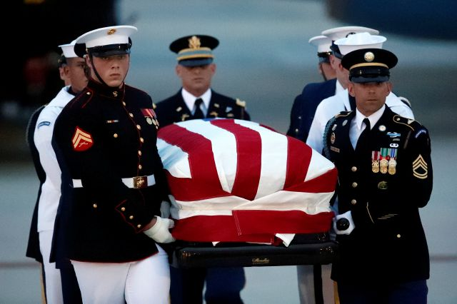 The flag-draped casket of Sen. John McCain, R-Ariz., is carried by an Armed Forces body bearer team to a hearse, Thursday, Aug. 30, 2018, at Andrews Air Force Base, Md. (AP Photo/Alex Brandon)