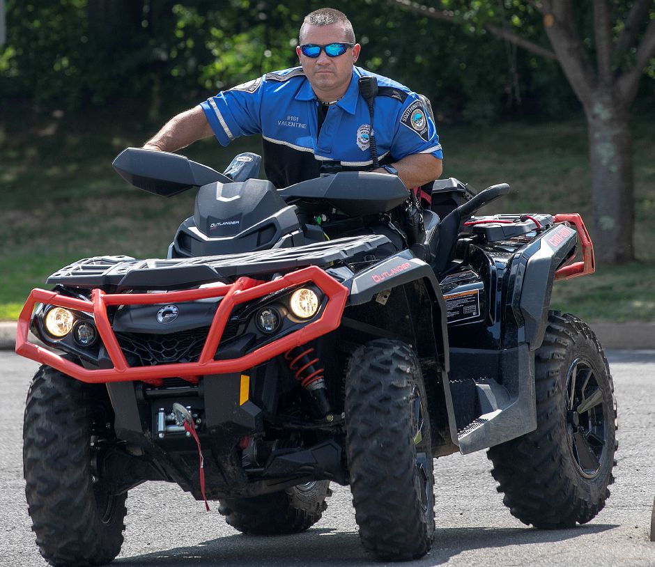 Ofc. Jim Valentine rides a quad in the parking lot of the Southington Police Dept. before heading out on patrol, Mon., July 29, 2019. Police will be patrolling town and Water Department land in hopes of curtailing illegal ATV and dirt bike use as well as poaching. Dave Zajac, Record-Journal