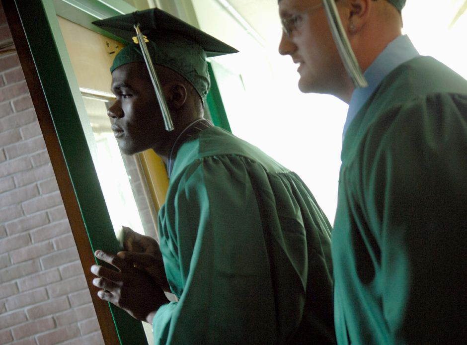 MERIDEN, Connecticut - Tuesday, June 17, 2008 -Guerinah Bonhomme, left, and Deverick Bookey look down the hallway towards the stage/crowd as they wait in anticipation before the Maloney Class of 2008 graduation exercises on Tuesday, June 17, 2008. Rob Beecher / Record-Journal