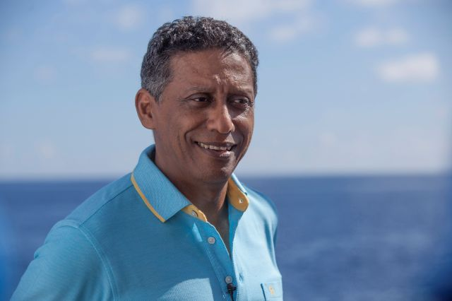 In this Saturday, April 13, 2019, photo, Seychelles President Danny Faure smiles during an interview with the Associated Press, on board the vessel Ocean Zephyr off the coast of Desroches, in the outer islands of Seychelles. President Faure was visiting a British-led science expedition exploring the depths of the Indian Ocean where scientists documented changes taking place beneath the waves that could affect billions of people in the surrounding region over the coming decades. (AP...