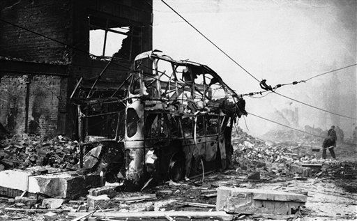 The remains of a bomb wrecked trolley bus, a victim of the Luftwaffe?s large scale dive bombing attack in Coventry, England on Nov. 14, 1940. (AP Photo)