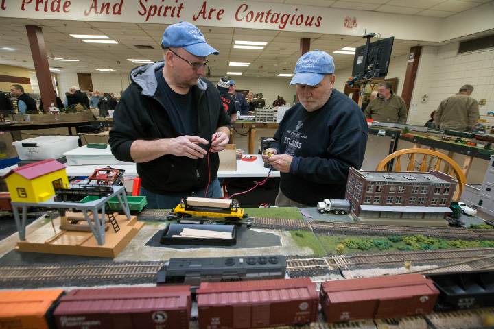 Paul Krause, left, of New Milford, and Vinny Manjoney, of Stratford, work to diagnose an electrical short Sunday during a model train show at Cheshire High School. | Photos by Justin Weekes, Special to the Record-Journal