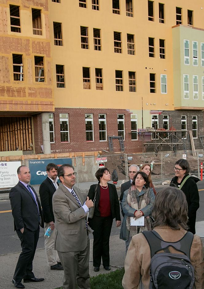 Pennrose Vice President Charlie Adams talks to a group next to the Meriden Commons while on a tour of downtown projects, Tuesday, October 17, 2017. Meriden Commons phase I has reached the halfway point and is on schedule, according to project developers. | Dave Zajac, Record-Journal