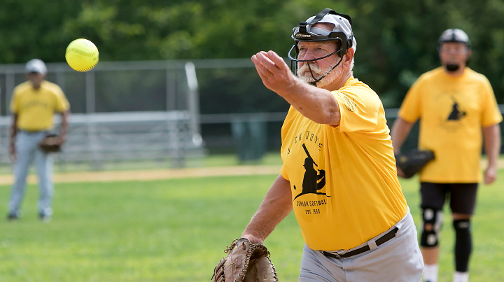 Larry Deschaine, 81, of Plymouth, delivers a pitch during a game against the Naturals in the Jack Doyle senior softball league at Pragemann Park in Wallingford, Monday, August 14, 2017. The Naturals defeated the Pirates 15-10. | Dave Zajac, Record-Journal