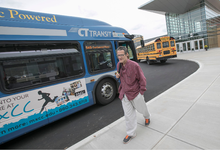 College student Daniel Maskell steps off a bus to the new Middlesex Community College campus at Platt High School in Meriden on Tuesday. He was the first student to use the new bus stop.| Photos by Dave Zajac, Record-Journal