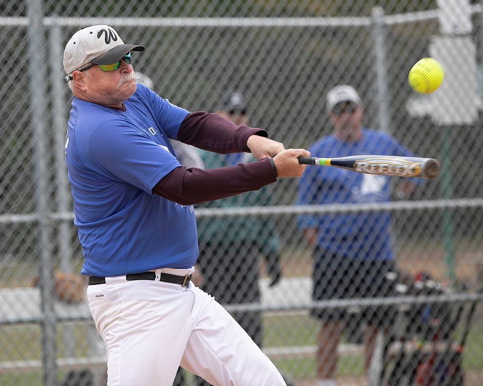 The Dodgers' Mark Pivin, of Wallingford, belts a home run against the Classics during the Jack Doyle Senior Softball League playoffs at Pragemann Park in Wallingford on Monday. The Classics defeated the Dodgers, 13-5. Photos by Dave Zajac, Record-Journal