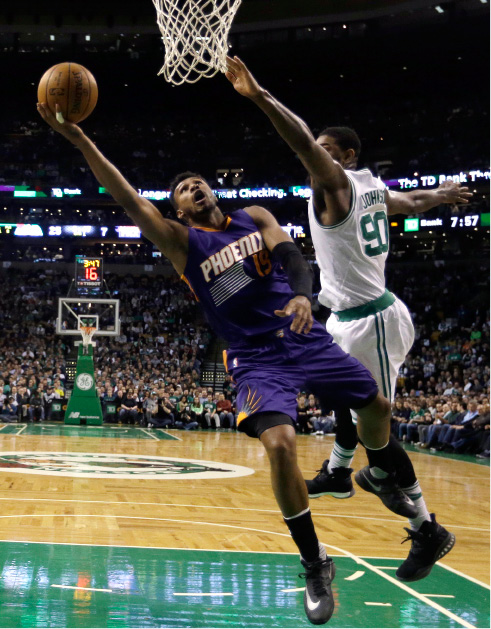 Phoenix Suns guard Leandro Barbosa (19) goes to the basket against Boston Celtics forward Amir Johnson (90) during the first quarter of an NBA basketball game, Friday, March 24, 2017, in Boston. (AP Photo/Elise Amendola)