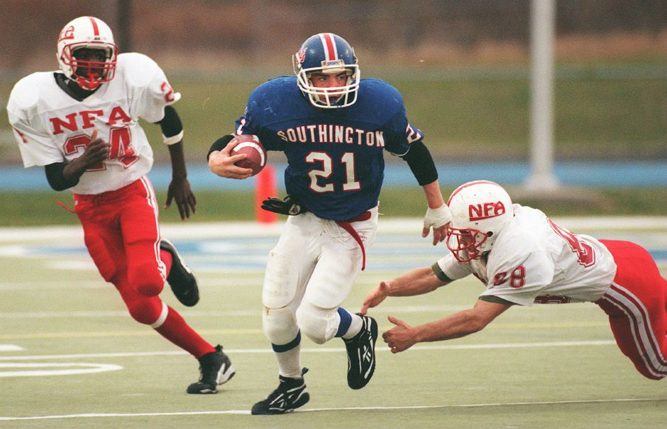 RJ file photo - Mike Cyr splits a pair of NFA players as he runs back an interception Dec. 5, 1998. The play was wiped out by a Southington penalty.