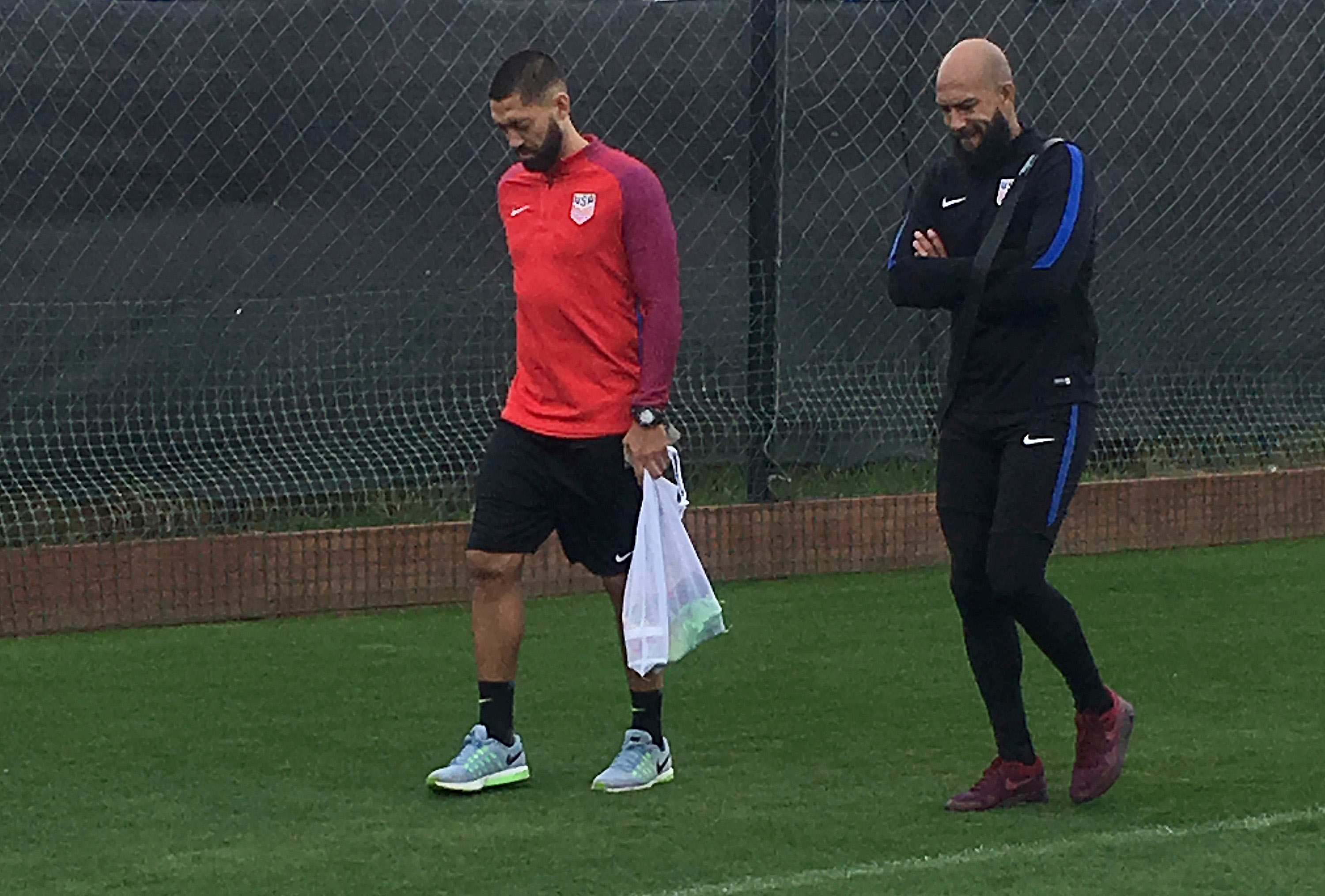 In this Friday, March 17, 2017, photo, U.S. goalkeeper Tim Howard, right, walks with forward Clint Dempsey on a soccer practice field in San Jose, Calif. The team will play its first qualifier against Honduras in San Jose on Friday, March 24, 2017. (AP Photo/Janie McCauley)