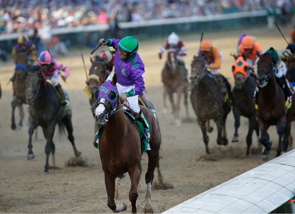 Victor Espinoza celebrates as he rides California Chrome to victory during the 140th running of the Kentucky Derby horse race at Churchill Downs Saturday, May 3, 2014, in Louisville, Ky. (AP Photo/David J. Phillip)