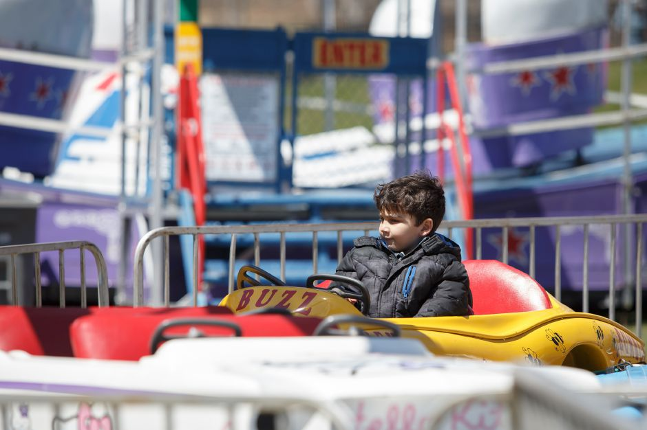 Savi Rivera 5 of New Britain enjoys a carnival ride Saturday during the Pre Daffodil Festival weekend at Hubbard Park in Meriden April 21, 2018 | Justin Weekes / Special to the Record-Journal