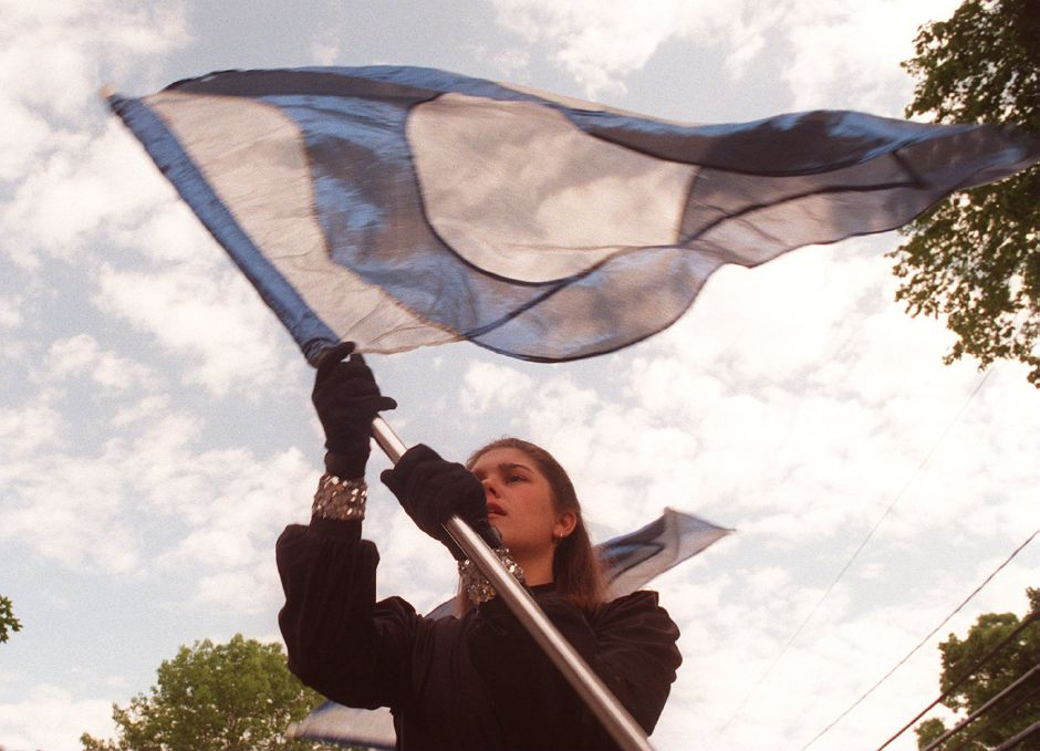 RJ file photo - Mary Anderson, a Lyman Hall High School senior, handles a flag as she and the school