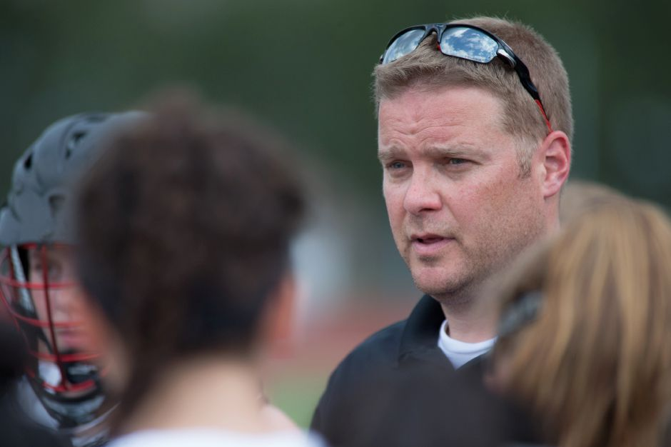 The Cheshire girls lacrosse team earned coach Dan Warburton career win No. 250 with Wednesday's 20-6 dusting of Jonathan Law in Milford. | Justin Weekes / Special to the Record-Journal