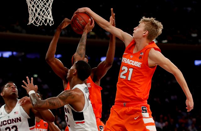 Syracuse forward Marek Dolezaj (21) blocks a shot by Connecticut guard Terry Larrier (22) during the first half of an NCAA college basketball game, Tuesday, Dec. 5, 2017, in New York. (AP Photo/Julie Jacobson)
