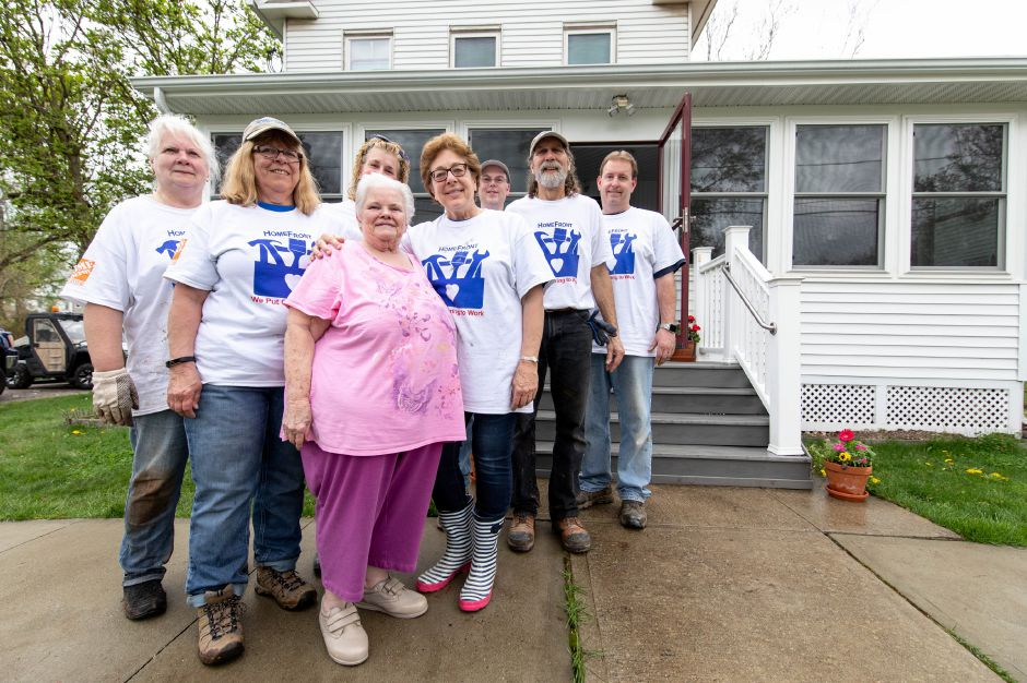 Catherine Zabrensky, third from left, stands with volunteers with HomeFront, a Stamford-based nonprofit which renovates homes for those are in need and unable to do the work themselves. Dozens of volunteers visited Zabrensky