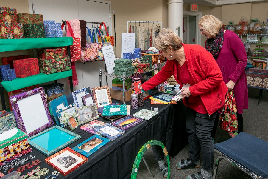 Church members Diane Szymaszek, left, and Trish Schneider set up for the 3rd annual Holiday Fair at The Unitarian Universalist Church, 328 Paddock Ave, Meriden, Fri., Dec. 6, 2019. The fair runs Friday Dec. 6 from 4 p.m. to 8 p.m. and Saturday Dec. 7 from 9 a.m. to 3 p.m.. The fair features raffle gift baskets as well as an array of artistic homemade crafts, ornaments, cookies by the pound, and other baked goods as well as a Christmas Boutique with gently used gifts. The Maloney High School Quartet will play live music on Friday from 5 p.m. to 7 p.m. Mac and cheese will be available on Friday. Santa will welcome children and pets for photos from 10 a.m. to 2 p.m.. on Saturday. Kid's activities will be held on Saturday. Dave Zajac, Record-Journal