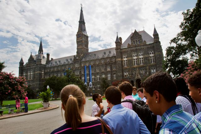 FILE - In this July 10, 2013, file photo, prospective students tour Georgetown University
