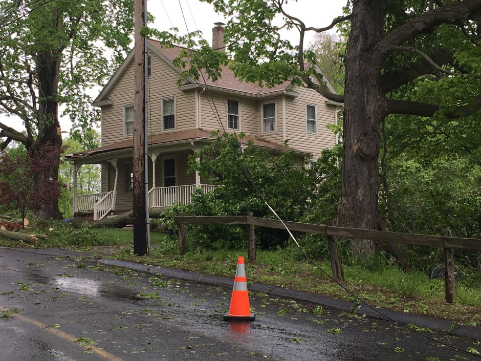 ​​​​​​​Durham resident Steven Willets came home Tuesday to find his home damaged and his wife's car crushed under a fallen tree branch. She was not in the vehicle and there were no reported injuries from the incident. | Lauren Takores, Record-Journal