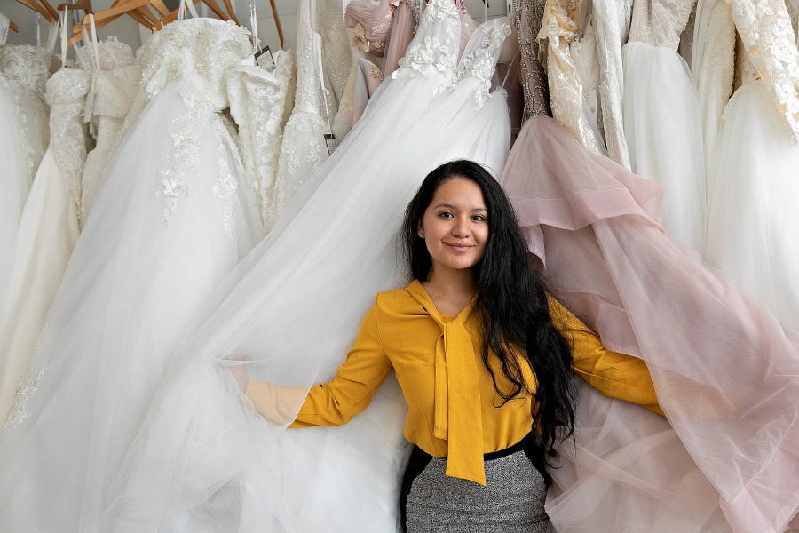 Jacqueline Torres poses with dresses she's designed at her bew business,  Jacqueline Bridal Kouture, at 314 N. Colony St. in Wallingford on Thursday. Photos by Dave Zajac, Record-Journal