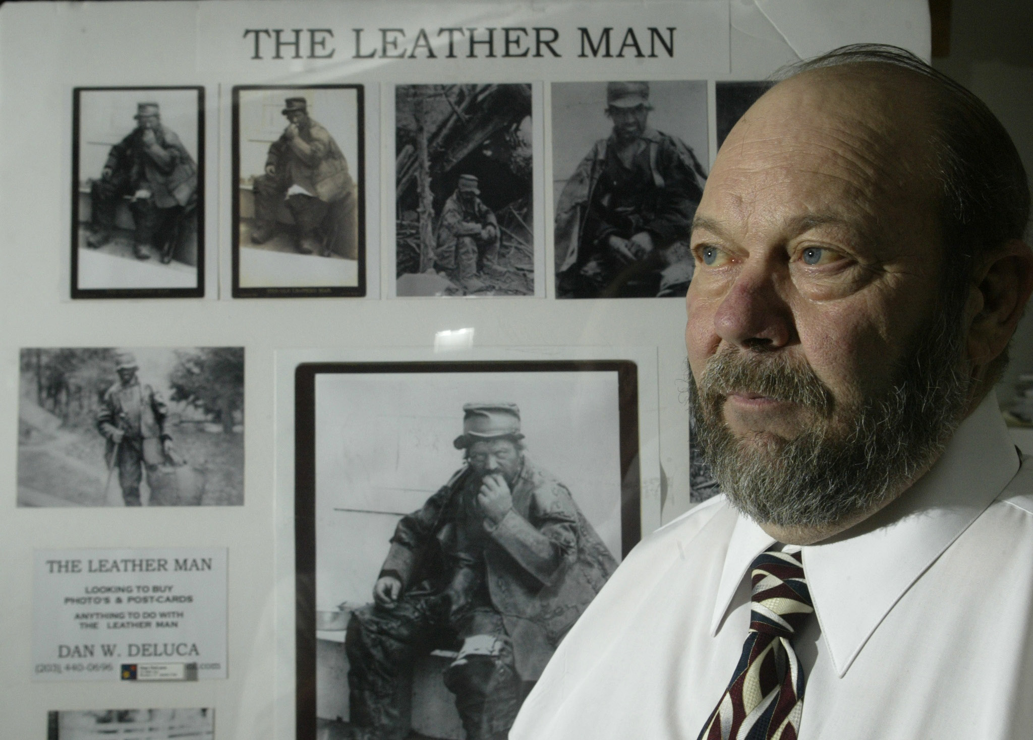 "File photo - Dan W. DeLuca, of Meriden, has been researching the life of the man known as the ""Leather Man"" for seventeen years.  Here DeLuca stands infront of a display board that shows off only a small fraction of his collection of Leather Man photos and post cards. DeLuca guesses that he has a few thousand newspaper articles and photographic pieces of the Leather Man. 