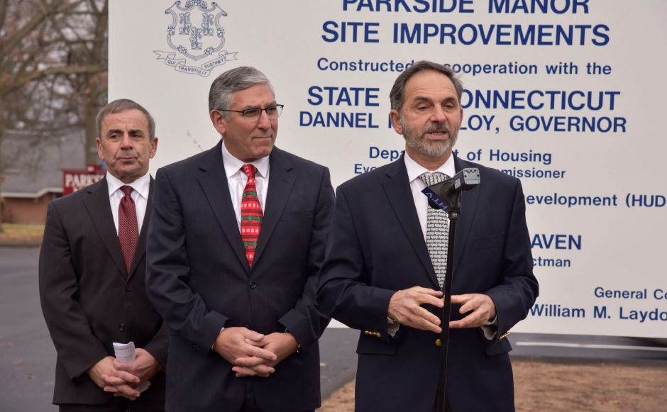 State Rep. David Yaccarino makes remarks during a dedication of new site improvements at Parkside Manor Housing Complex on Monday, Dec. 17, 2018. State Sen. Len Fasano, center, also made brief remarks. The town recently completed exterior site improvements and replacement of the fire alarm system thanks to a grant from the U.S. Department of Housing and Urban Devleopment through the Small Cities Program. | Bailey Wright, Record-Journal