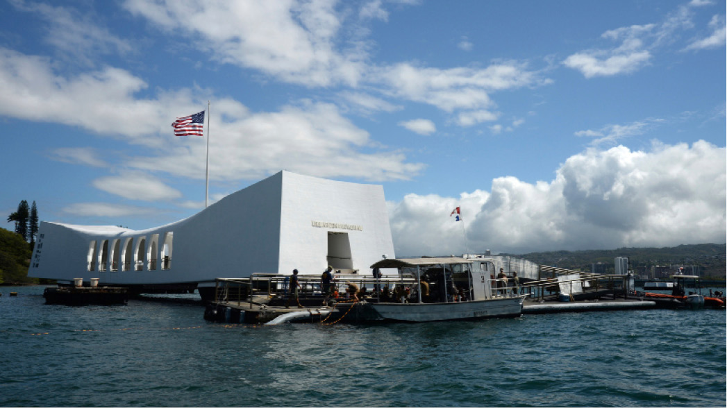 FILE- In this June 3, 2015 file photo released by the U.S. Navy, sailors work to repair the floating dock next to the USS Arizona Memorial in Pearl Harbor, Hawaii, after the USNS Mercy hospital ship struck the memorial