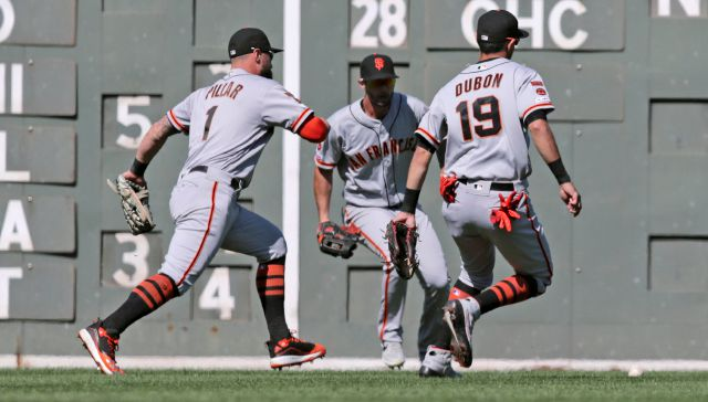 San Francisco Giants center fielder Kevin Pillar (1), shortstop Mauricio Dubon (19) and left fielder Joey Rickard, center, all chase down a single by Boston Red Sox