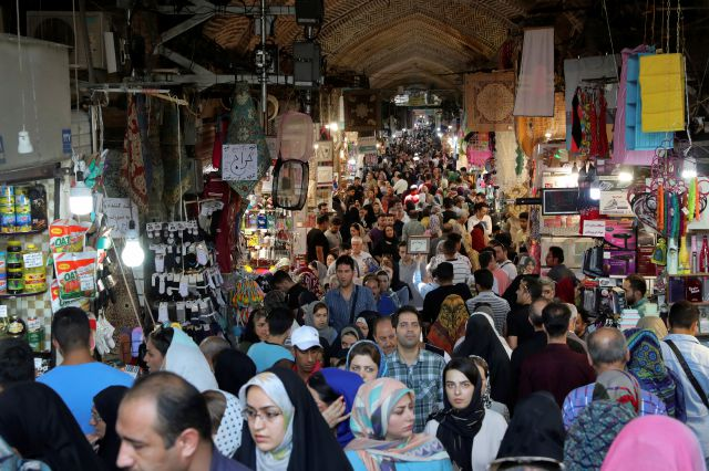 People shop at the old main bazaar in Tehran, Iran, Sunday, June 23, 2019. As the U.S. piles sanction after sanction on Iran, it's the average person who feels it the most. (AP Photo/Ebrahim Noroozi)