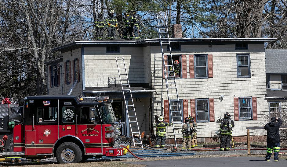 Firefighters on the scene of a house fire at 764 Marion Ave., Southington, Monday, April 1, 2019. Dave Zajac, Record-Journal