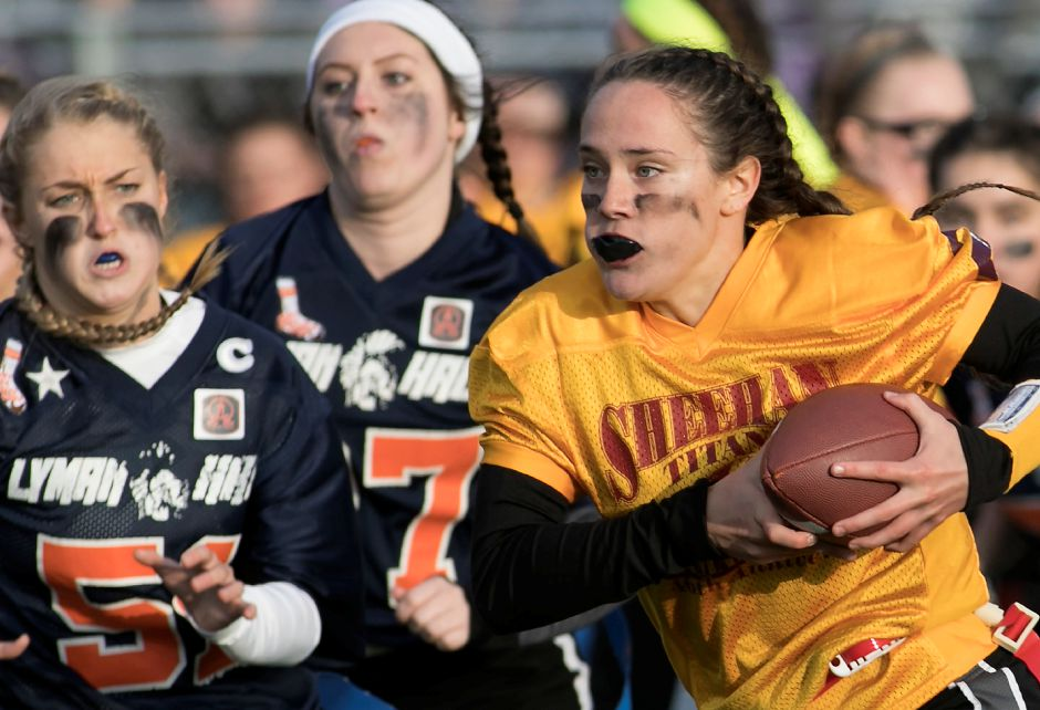 Sheehan quarterback Stephanie Phoenix looks for room on the outside as Lyman Hall defenders give chase in the first half of the annual Samaha Bowl at Lyman Hall High School in Wallingford, Wednesday, Nov. 22, 2017. | Dave Zajac, Record-Journal