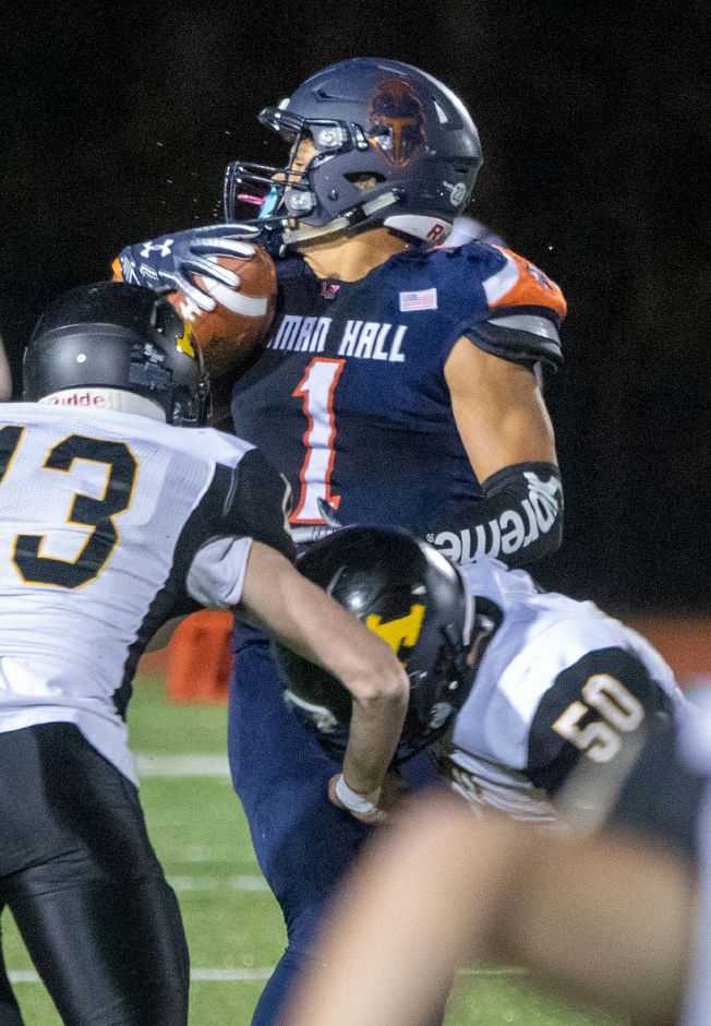 Lyman Hall play-maker Shakespeare Rodriguez saw plenty of double-teams from Amity during Friday night's game at Fitzgerald Field. On this reception, he is taken down by Andrew Mcgarry Gnidula and Daniel Patrick Cavanagh. Aaron Flaum, Record-Journal
