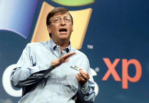 "Microsoft chairman Bill Gates speaks during the product launch of the new Windows XP operating system Thursday, Oct. 25, 2001, in New York. Gates touted the software as the harbinger of a new era in more Internet-centric computing. ""Today it really is actually the end of the MS-DOS era,"" Gates said. (AP Photo/Richard Drew)"