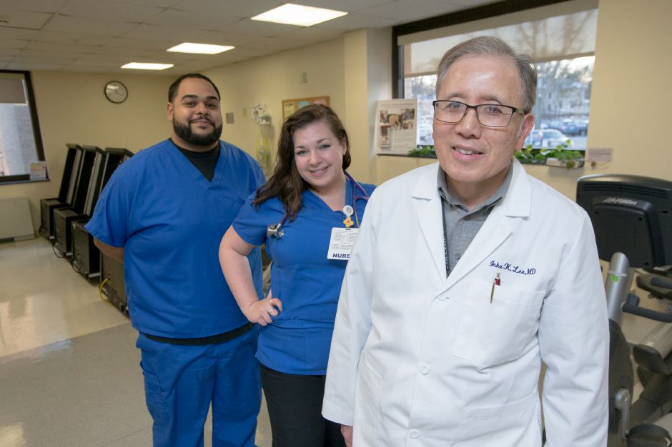 Dr. Inku Lee and nurses Christy Baker LPN and Anibal Sanchez Jr. LPN stand in the Cardiac Rehabilitation Center at Bradley Memorial The Hospital of Central Connecticut recently was re-credited by the American Association for Cardiovascular and Pulmonary Rehabilitation for provided patients care to the standards of the AACVPR Tuesday in Southington December 26, 2017 | Justin Weekes / For the Record-Journal