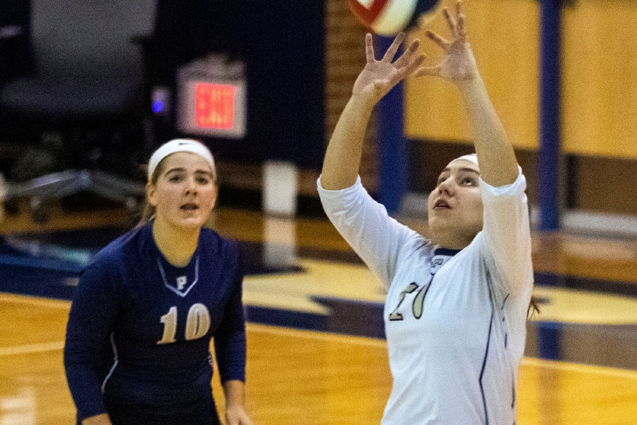 Ashlee Long makes a pass for the Panthers during Monday's first-round CIAC Class M girls volleyball tournament game at Platt. The Panthers swept visiting New London 3-0. Aaron Flaum, Record-Journal
