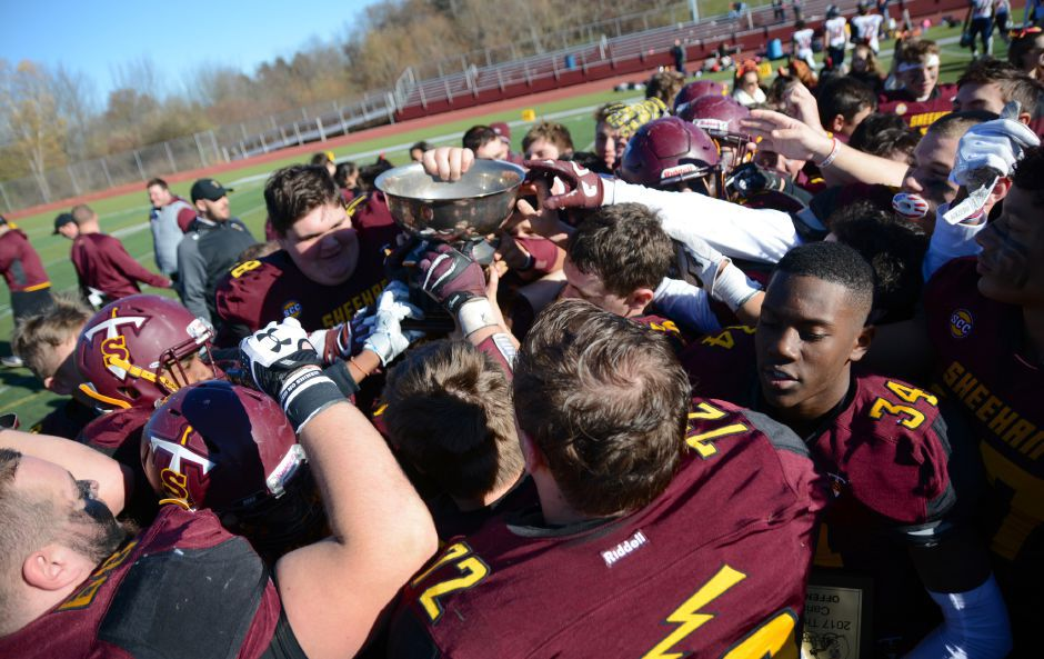 Members of the Sheehan football team celebrate with the Carini Bowl after defeating Lyman Hall in the team's annual Thanksgiving Day football game on Thursday at Riccitelli Field at Sheehan High School in Wallingford. More photos and a video online at MyRecordJournal.com Bryan Lipiner, Record-Journal