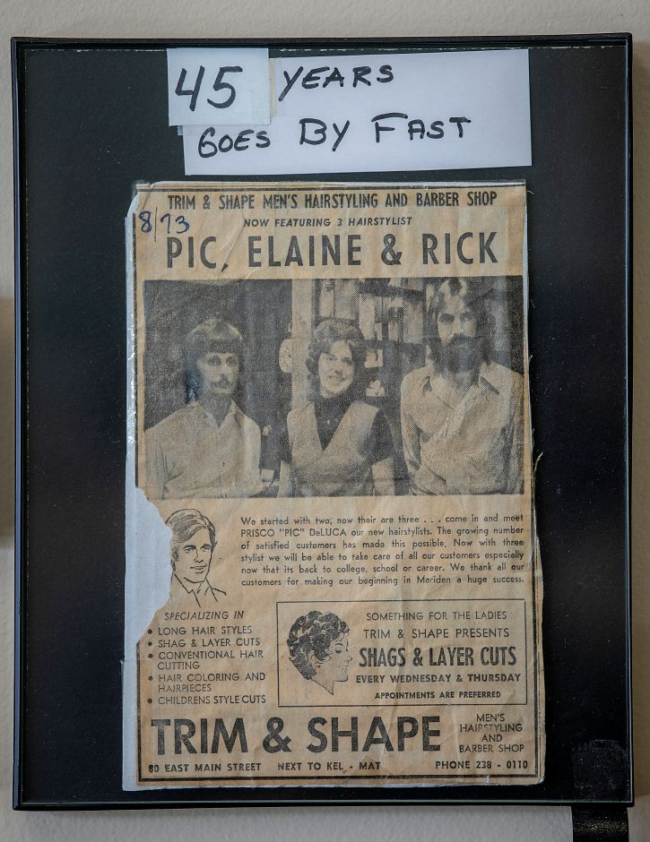 "A framed clipping from August 1973 featuring Barber Prisco ""Pic"" DeLuca, left, when he first started as a barber at the former Trim & Shape Barber Shop on East Main Street, Meriden. Dave Zajac, Record-Journal"
