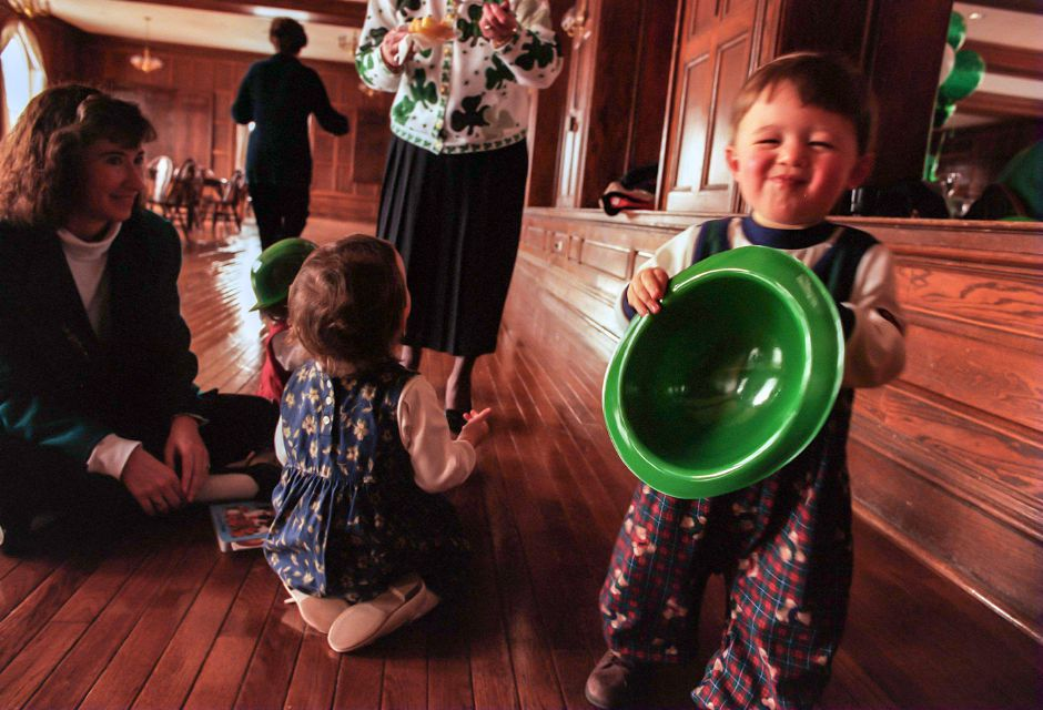 RJ file photo - Holding a green derby, 14-month-old Nathaniel Shemo of Wallingford grins while having fun at the Wallingford Historic Preservation Trust St. Patrick