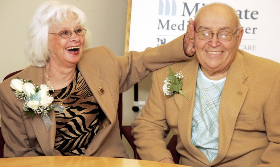 Lillian Adinolfi with her husband Al Adinolfi before his swearing in at MidState Medical Center Wed., Jan. 3 by Wlf. Town Clerk Barbara Thompson. He is recuperating from a bout of pneumonia.