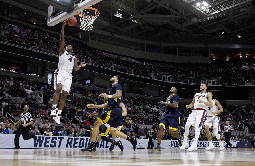 Gonzaga guard Jordan Mathews, top left, drives to the basket against West Virginia during the first half of an NCAA Tournament college basketball regional semifinal game Thursday, March 23, 2017, in San Jose, Calif. (AP Photo/Tony Avelar)