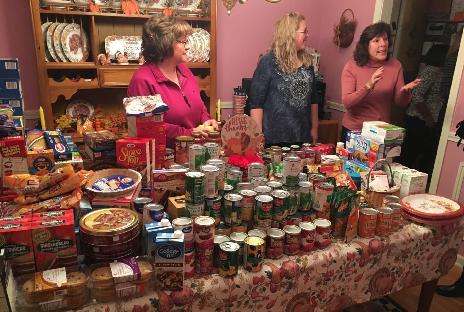 The Lady Nighters prepare to pack food into baskets for the needy. The group gathered at the home of Maggie Colantonio on Nov. 13, 2018. /Ryan Chichester, Record-Journal