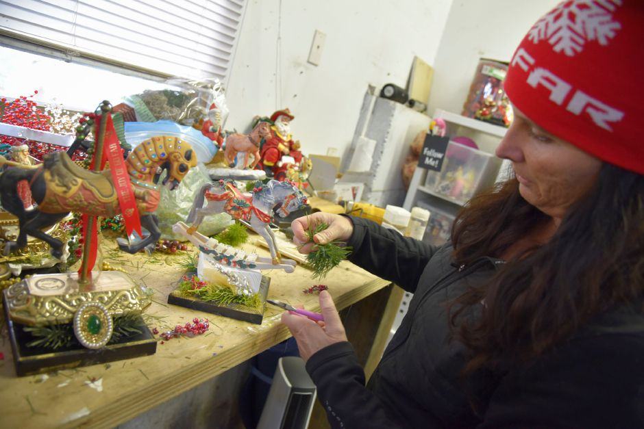 Jennifer Schulten, founder of Go Far, in the workshop where she and a fellow race coordinator put together unique homemade trophies for the fastest and most festive runners of their annual Go Far Jingle All the Way 5K, which is on Dec. 16, 2018. | Bailey Wright, Record-Journal