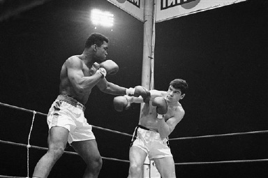 Heavyweight champion Muhammad Ali connects with a left to Karl Mildenberger of Germany in second round of title bout in Frankfurt, Germany on Sept. 10, 1966.  Ali retained his title as the referee stopped the bout in the 12th of the 15-rounder to prevent more damage to the bleeding German. (AP Photo)