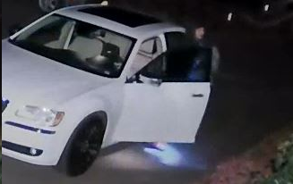 Screenshots of a surveillance video recorded by a Durham resident show a suspect looking through an unlocked car. Police say overnight thefts from cars has increased in the last few weeks. | Courtesy State Police