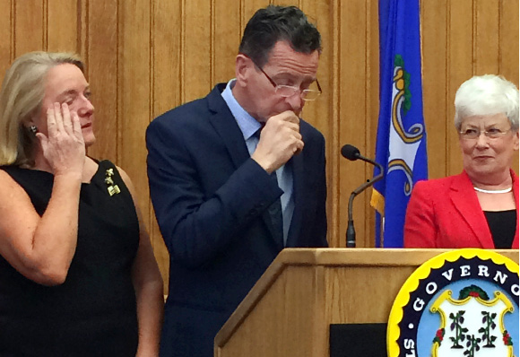 Connecticut Gov. Dannel P. Malloy pauses after announcing at the Capitol in Hartford that he will not seek a third term in 2018. He is flanked by his wife, Cathy, left, and Lt. Gov. Nancy Wyman.| AP Photo/Susan Haigh)