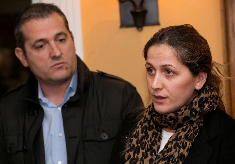 Denada Rondos, right, answers questions next to husband, Viron, left, during a press conference at Viron Rondo Osteria in Cheshire, Friday, Nov. 10, 2017. Rondos, who came to the United States in 2002 and helps run Viron Rondo Osteria, faces deportation back to Albania. | Dave Zajac, Record-Journal