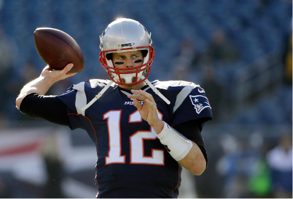 FILE - IN this Sunday, Dec. 4, 2016 file photo, New England Patriots quarterback Tom Brady warms up before an NFL football game against the Los Angeles Rams in Foxborough, Mass. As usual, the Patriots are pushing for the AFC
