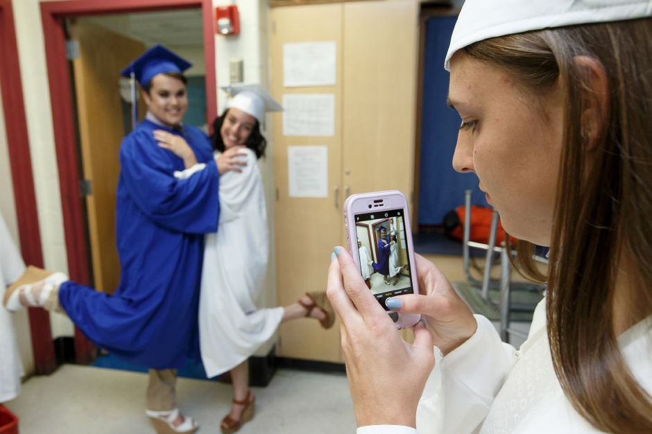 Elise Hastings right takes a picture of classmates Peter Kszgwanos left and Audrey Hajducky Friday during Lyman Hall High School