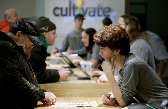 Customers purchase recreational marijuana at the Cultivate dispensary on the first day of legal sales, Tuesday, Nov. 20, 2018, in Leicester, Mass. Cultivate is one of the first two shops permitted to sell recreational marijuana in the eastern United States, more than two years after Massachusetts voters approved it in 2016. (AP Photo/Steven Senne)