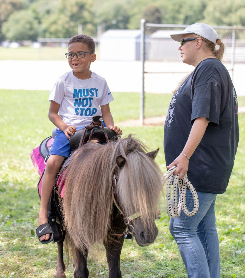 Anthony Murray rides on a pony during the Plainville Fun Day. The annual celebration was held at Norton Park on August 9, 2019. | Devin Leith-Yessian/Plainville Citizen